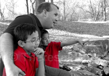 2014 Dad and Sons on lake Eric pointing BW Red