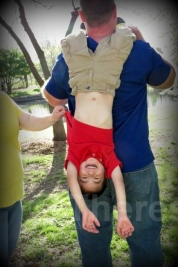 2014 Eric hanging from Dad's shoulder