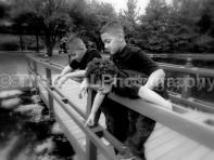 boys on Bridge looking BW