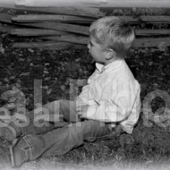 Elliott sitting on haybale looking 2013 BW