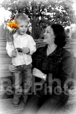 Elliott giving sunflower to Jeanine 2013 BW Closeup