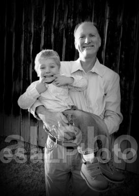 John holding Elliott SMILING w fingers 2013 BW
