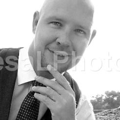 Ben Portrait hand on chin vertical BW IMG_1021